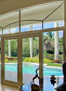 Home Watch Sarasota - Swimming Pool